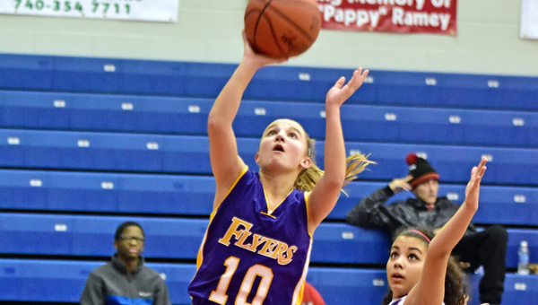 St. Joseph Female Flyers' Morgan Turner (10) drives and scores two of her 12 points on a layup during Wednesday's game at Portsmouth. The Female Flyers won 36-31. (Kent Sanborn of Southern Ohio Sports Photos)