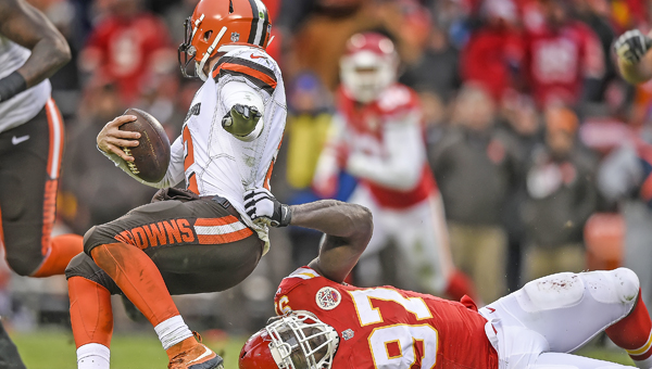 Kansas City Chiefs defensive end Allen Bailey (97) tries to hang on for the tackle of Cleveland Browns quarterback Johnny Manziel (2) during the third quarter on Sunday at Arrowhead Stadium in Kansas City, Mo. Manziel threw for 136 yards and ran for 108 but the Browns lost 17-13. (David Eulitt/Kansas City Star/TNS)