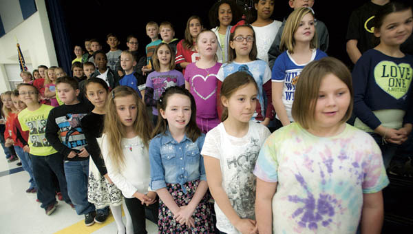 Students from South Point Elementary School rehearse for their Christmas program on Tuesday.