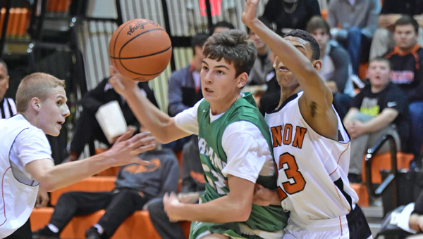 Fairland Dragons' Gunner Short (52) drives into the lane as Ironton Fighting Tigers' Marques Davis (23) defends. Fairland downed Ironton 45-38 on Tuesday in an OVC game. (Kent Sanborn of Southern Ohio Sports Photos)