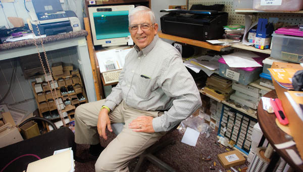 Longtime Mayor Dick Gilpin, sits inside his business, Gilpin's Creative Trophies, as he reminisces over his terms as village mayor.