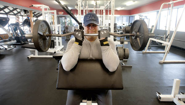 William Crockrel works out at Tri-State Rehab and Fitness, located on South Third Street, Tuesday morning.