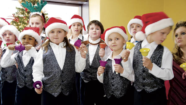 The bell choir from the Open Door School in Ironton performs Christmas songs for residents at Jo-Lin Health Center on Thursday.