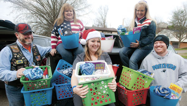 Tom Epperly, Linda Myers, Mariah Noel, Pattie Heaberlin and Josh Noel, left to right, have collected numerous items to be handed out to the veterans this holiday. Not pictured are Janet Murnahan and Vickie Jenkins, who also helped.