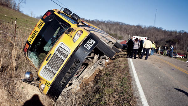A South Point school bus was on its side along a ditch on State Route 243, around the 10-mile marker Tuesday afternoon. Ten were sent to the hospital.