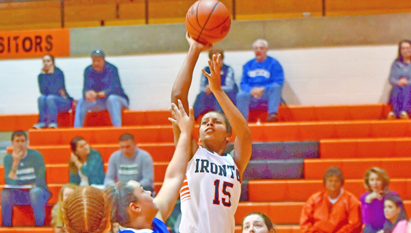 Ironton Lady Fighting Tigers' Lexie Barrier  scored 24 points to make her the girls' all-time career scoring leader. She now has 1,391 points. (Kent Sanborn of Southern Ohio Sports Photos)