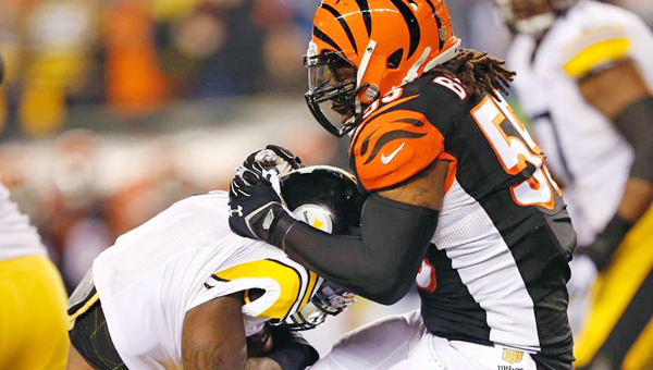 Cincinnati Bengals' linebacker Vontaze Burfict (right) makes a stop on a Pittsburgh Steelers' running back. Burfict's 15-yard personal foul helped set up the Steelers' winning field goal on Saturday in the NFL Wild Card playoff game. (Courtesy of The CIncinnati Bengals.com)
