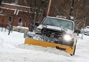 Ironton City workers are seen out on the street in Ironton as they work to clear city roads Saturday.