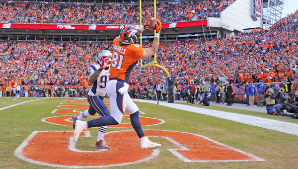 Denver Broncos' wide receiver Owen Daniels (81) gathers in the second of two first-half touchdown catches during the first quarter of the AFC Championship game on Sunday in Denver. The Broncos beat the New England Patriots 20-18 to win the AFC title. (MCT Direct Photos)
