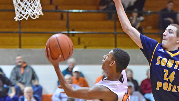 Ironton Fighting Tigers' Marques Davis (23) drives for a layup as he scores two of his 17 points. Ironton beat South Point 49-32 on Tuesday in an Ohio Valley Conference game. (Kent Sanborn of Southern Ohio Sports Photos)