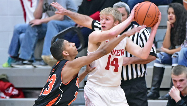 Ironton Fighting Tigers' Marques Davis (23) applies defensive pressure while Rock Hill's Nathan Turvey looks to make a pass to a teammate. Ironton beat the Redmen 47-35 on Tuesday. (Kent Sanborn of Southern Ohio Sports Photos)