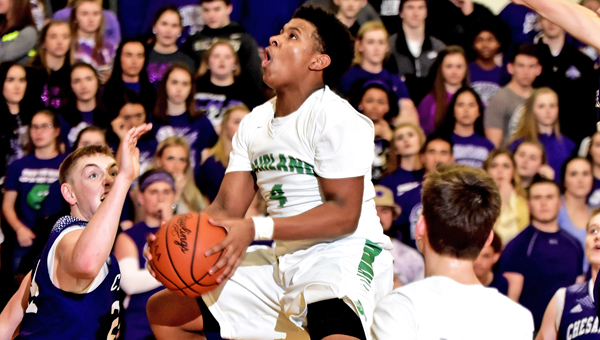 Fairland Dragons' Isaiah Howell (4) leaps into the air as he goes inside to try and score against the Chesapeake Panthers on Friday in a battle for first place in the Ohio Valley Conference. Fairland won 72-61. (Kent Sanborn of Southern Ohio Sports Photos)