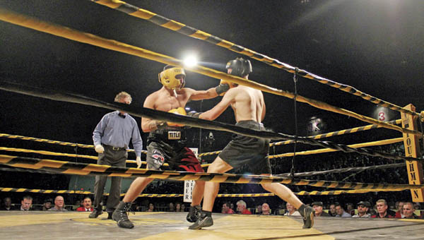 Fighters compete in the 37th annual West Virginia Toughman Contest Friday night at the Big Sandy Superstore Arena in Huntington.