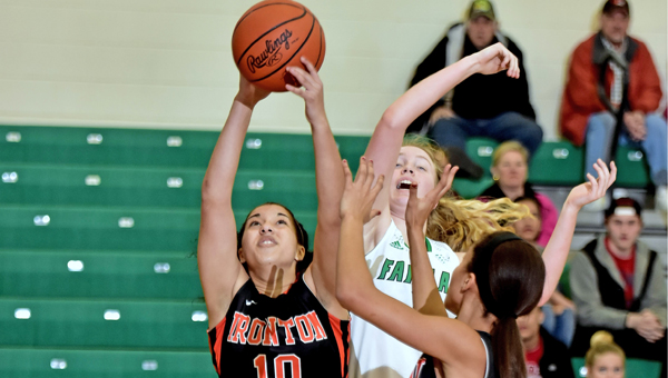 Ironton Lady Fighting Tigers' D'Laynie Keith (10) grabs a rebound despite the efforts of Fairland Lady Dragons' Alesha Simpson. Ironton beat Fairland 44-34. (Kent Sanborn of Southern Ohio Sports Photos)