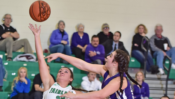 Fairland Lady Dragons Taylor Perry (24) shoots a layup while Chesapeake Lady Panthers Kaylee Curry (right) attempts to block the shot. Fairland held on a for a 45-44 Ohio Valley Conference win on Thursday. (Kent Sanborn of Southern Ohio Sports Photos)