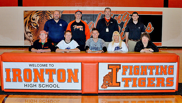 Ironton Fighting Tigers' senior pitcher Cody Rawlins signed a letter-of-intent on Wednesday to play baseball at Shawnee State University. Attending the signing ceremony were: seated from left to right, Ray Collins, brother Cory Rawlins, Cody, mother Lena Rawlins and Jodi Rowe-Collins; standing left to right, Shawnee State head coach Chris Moore, Ironton head coach Larry Goodwin and Ironton assistant coaches Jim Williams and Ryan Hackworth. (Tony Shotsky of Southern Ohio Sports Photos)