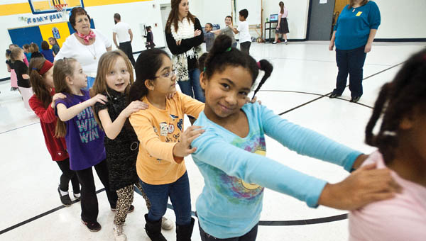 Rachae Patrick is in the conga line during the annual Sock Hop event at Burlington Elementary School Friday.