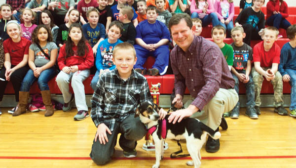 Symmes Valley Elementary School student Isaac Callicoat  poses with his dog, Lady, and Lawrence County Auditor  Jason Stephens after being presented Top Dog winner of 2016.