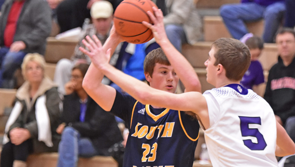 Chesapeake Panthers' Kolton Webb (5) applies defensive pressure while South Point Pointers' Jared Whitt (23) looks for an open teammate. The Panthers beat the Pointers 58-46 on Wednesday in an Ohio Valley Conference game. (Kent Sanborn of Southern Ohio Sports Photos)