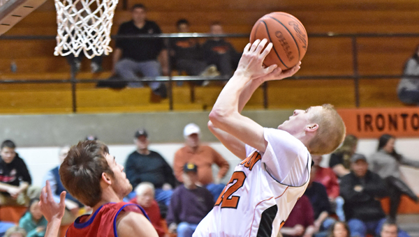 Ironton Fighting Tigers' Ethan Wilson (12) hits a shot inside the lane for two of his 15 points. Ironton lost to Portsmouth 66-50 on Tuesday in an Ohio Valley Conference game. (Kent Sanborn of Southern Ohio Sports Photos)