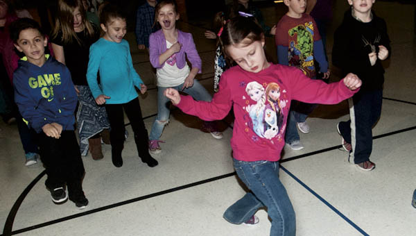 Ariane Cooper gets her groove on during the South Point Elementary dance party.