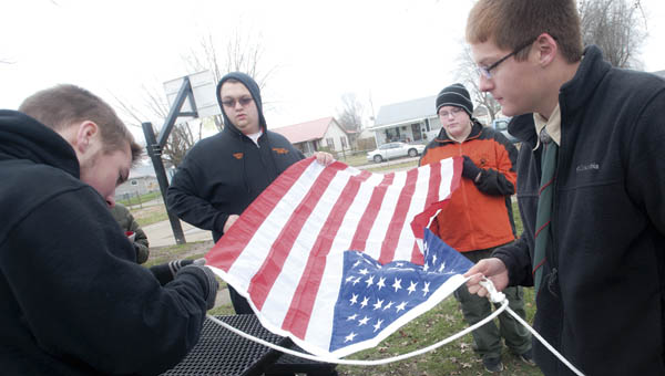 Pictured left to right, Wyatt Boggs, Parker Rowe, Dylan Spurlock and Cory Rawlins, work to put together and erect a new flagpole at the Edna Kopacz Park in Ironton.