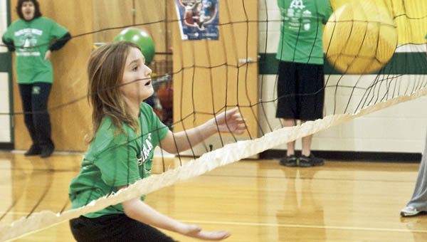 Noah Marcum returns a serve during a game of volleyball as part of a special athletic event at Fairland West.