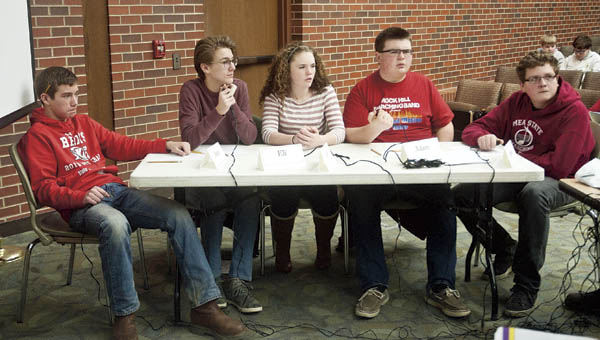 Rock Hill students, from left to right, Brady Floyd, Eli Baker, Lucy Simpson, Adam Fleeman and Jacob Gnau listen as the pronouncer reads off questions in the final rounds against Symmes Valley during the Lawrence County Middle School Quiz Bowl Tournament Tuesday at Ohio University Southern.