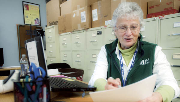 Sherry Popp with VITA helps with tax preparation on Thursday at the Work Force Development Center in Irotnon.