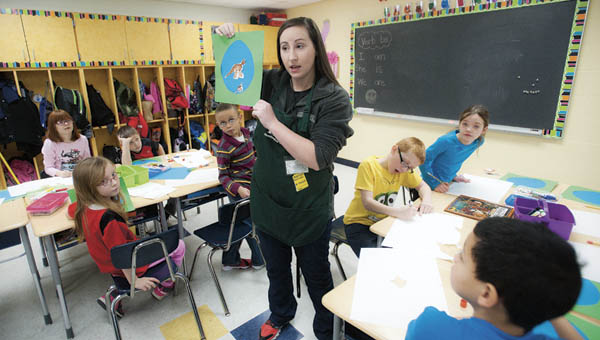 Kelli Harrah, with the Huntington Museum of Art, instructs students from Burlington Elementary School during a special art presentation Wednesday.