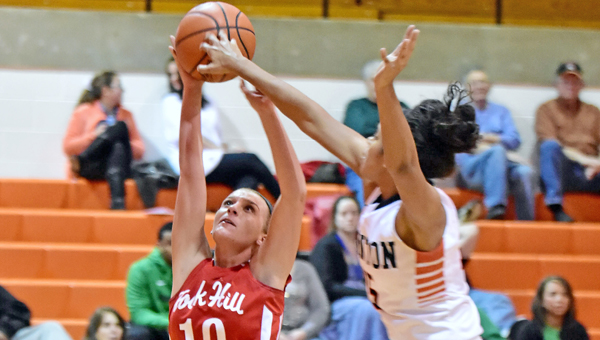 Ironton Lady Fighting Tigers' Lexie Barrier (right) blocks a shot during Monday's Ohio Valley Conference game. Ironton beat the Rock Hill Redwomen 82-48 to finish the regular season with their first-ever unbeaten record a 22-0. (Kent Sanborn of Southern Ohio Sports Photos)