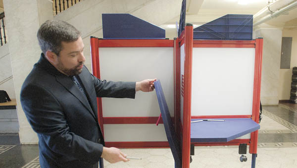 Ironton attorney Mark McCown shows off the county's new voting booths.