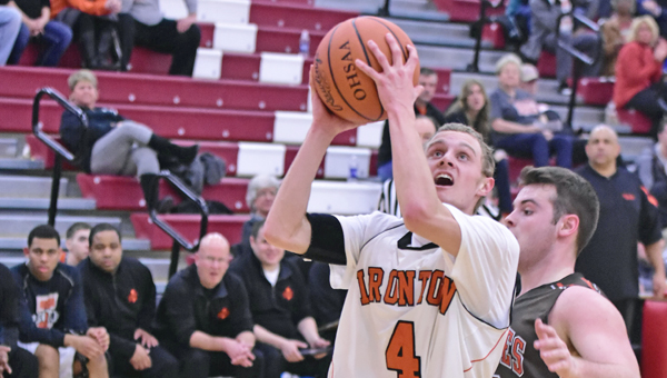 Ironton Fighting Tigers' Phil Kratzenberg (4) drives past a Nelsonville-York defender to make a layup during Tuesday's Division III sectional tournament. Ironton won 52-38. (Kent Sanborn of Southern Ohio Sports Photos)