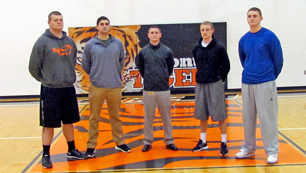 Basketball has been a family affair for the Ironton Fighting Tigers this season. From left to right are cousins Tyler Webb, Kyle Bryant, assistant coach Chase Kratzenberg, Phil Kratzenberg and Ryan Bryant. All five are out of the Bob Kratzenberg family tree. (Tony Shotsky of Southern Ohio Sports Photos)