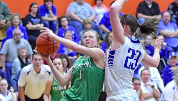 Fairland Lady Dragons' Allie Marshall (1) drives for a layup against Southeastern's Ella Skeens (23) during Thursday's Division III district semifinals. Fairland beat Southeastern 56-50 to reach the district finals. (Kent Sanborn of Southern Ohio Sports Photos)