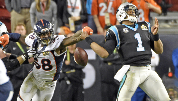 Denver Broncos outside linebacker Von Miller (58) strips the ball from Carolina Panthers quarterback Cam Newton (1) in the fourth quarter in Super Bowl 50 at Levi's Stadium in Santa Clara, Calif., on Sunday. The Broncos won, 24-10. (MCT Direct Photo.com)
