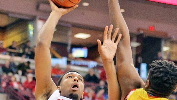 Tevor Thompson (32) of the Ohio State Buckeyes puts up a shot over Diamond Stone (33) of the Maryland Terrapins in the second half on Sunday at Value City Arena in Columbus. Maryland defeated Ohio State 66-61. (Photo by Jamie Sabau/Getty Images)