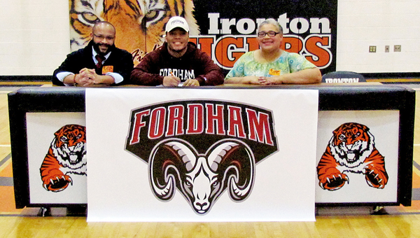 Ironton Fighting Tigers' senior running back D'Angelo Palladino signed a national letter-of-intent to play football at Fordham University on Wednesday. Attending the ceremony were, from left to right, uncle Stacey Jones, D'Angelo, and mother Latisha Palladino. (Tony Shotsky of Southern Ohio Sports Photos)