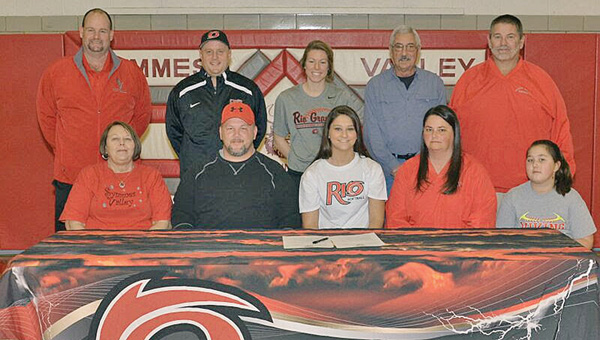 """Symmes Valley Lady Vikings' senior softball standout Kaitlyn Payne signed a letter-of-intent with the University of Rio Grande on Thursday. Attending the ceremony were: seated from left to right, grandmother Dolly Payne, father Shannon Payne, Kaitlyn, mother Erin Payne and sister Kailee Payne; standing left to right, coach Rusty Webb, Rio Grande head coach Chris Hammond, Rio Grande assistant Kaylee Walk, Lady Vikings' assistant Chuck Renfroe and Vikings' head coach Jeff """"Odie Estep. (Robert S. Stevens & The Gold Studio Of Ironton)"""
