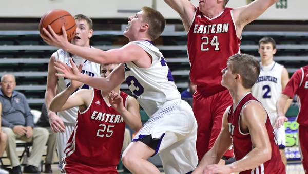 Chesapeake Panthers' guard Gage Rhoades (23) hits a driving layup for two of his 14 points during Sunday's 47-39 Division III district semifinal win over Eastern Brown. (Kent Sanborn of Southern Ohio Sports Photos)