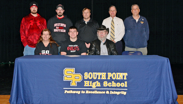 South Point Pointers' senior lineman Joey Riner signed a letter-of-intent Thursday to play football at Kentucky Christian University. Attending the signing were: seated from left to right, mother Barbara Edwards, Joey and father Jim Riner; standing left to right, brothers J.T. and Matt, Pointers' head coach Chad Coffman, former South Point head coach Rick Marcello and South Point athletic director Dave Adams.