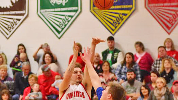 Symmes Valley Vikings' Derrek Smith (21) lets fly with a 3-point attempt during a recent game. The Vikings beat the St. Joseph Flyers 65-36 on Saturday. (Robert S. Stevens of The Gold Studio in Ironton)