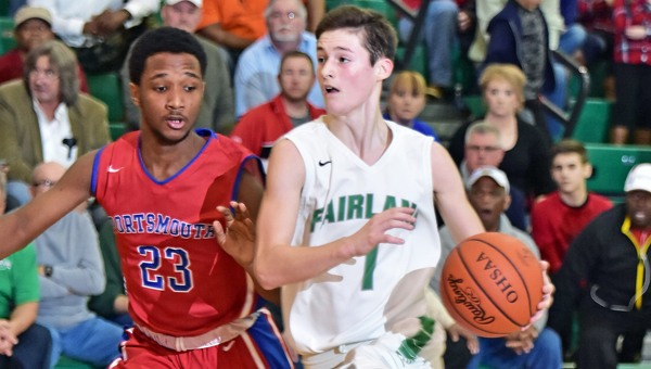 Fairland Dragons' point guard Ty Staten (1) takes the ball down the lane against Portsmouth's Dakota Reynolds (23) during Friday's game. Fairland won 75-72 in overtime to clinch at least a share of the Ohio Valley Conference championship. (Kent Sanborn of Southern Ohio Sports Photos)
