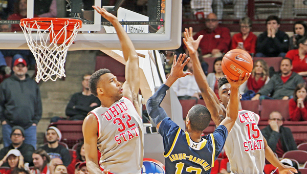 Ohio State Buckeyes guard Kam Williams (15) blocks the shot of Michigan Wolverines guard Muhammad-Ali Abdur-Rahkman (12) with the inside help from center Trevor Thompson (32) during the second half on Tuesday at Value City Arena in Columbus. ((Kyle Robertson/Columbus Dispatch/TNS))