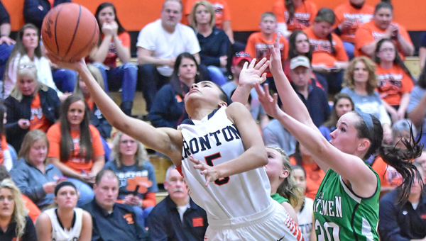 Ironton Lady Fighting Tigers' guard Lexie Wise (5) drives through Huntington Ross defenders during Monday's Division III district tournament semifinal game. Ironton beat the Lady Huntsmen 73-42 to reach Saturday's district finals against North Adams at 8 p.m. (Kent Sanborn of Southern Ohio Sports Photos)