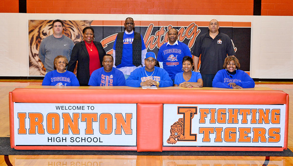 Ironton Fighting Tigers' senior All-Ohio football standout Desmond Young signed a letter-of-intent to play at Savannah State University in Georgia. Attending the celebration on Thursday were: seated from left to right, Loretta Vinson, father Joe Young, Desmond Young, mother Anissa Young and Rena Cosby; standing from left to right, Ironton head coach Mark Vass, Darlene Ingram, George Cosby, Leonard Irvin and Ironton atheltic director Mark LaFon. (Kent Sanborn of Southern Ohio Sports Photos)