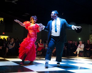 Brenda Martin and Rick Payne perform a salsa dance during the Dancing with Our Stars event Saturday evening.