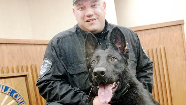 Lawrence County Sheriff's Deputy Steve Sisler with the department's latest member K9 Johnny.