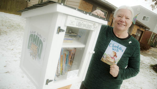 Lois Terkhorn displays her Little Free Library, located on Kevin Street, on the north end of Ironton.