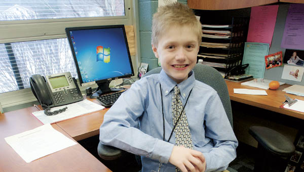 Fourth grader Owen Johnson makes himself right at home in the principal's office at Dawson-Bryant Elementary School. Owen is one of four at the school who got to play grown-up for the day following an auction for the positions during the school's fall festival.